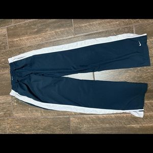 Women's Nike windsuit pants. Navy and white.